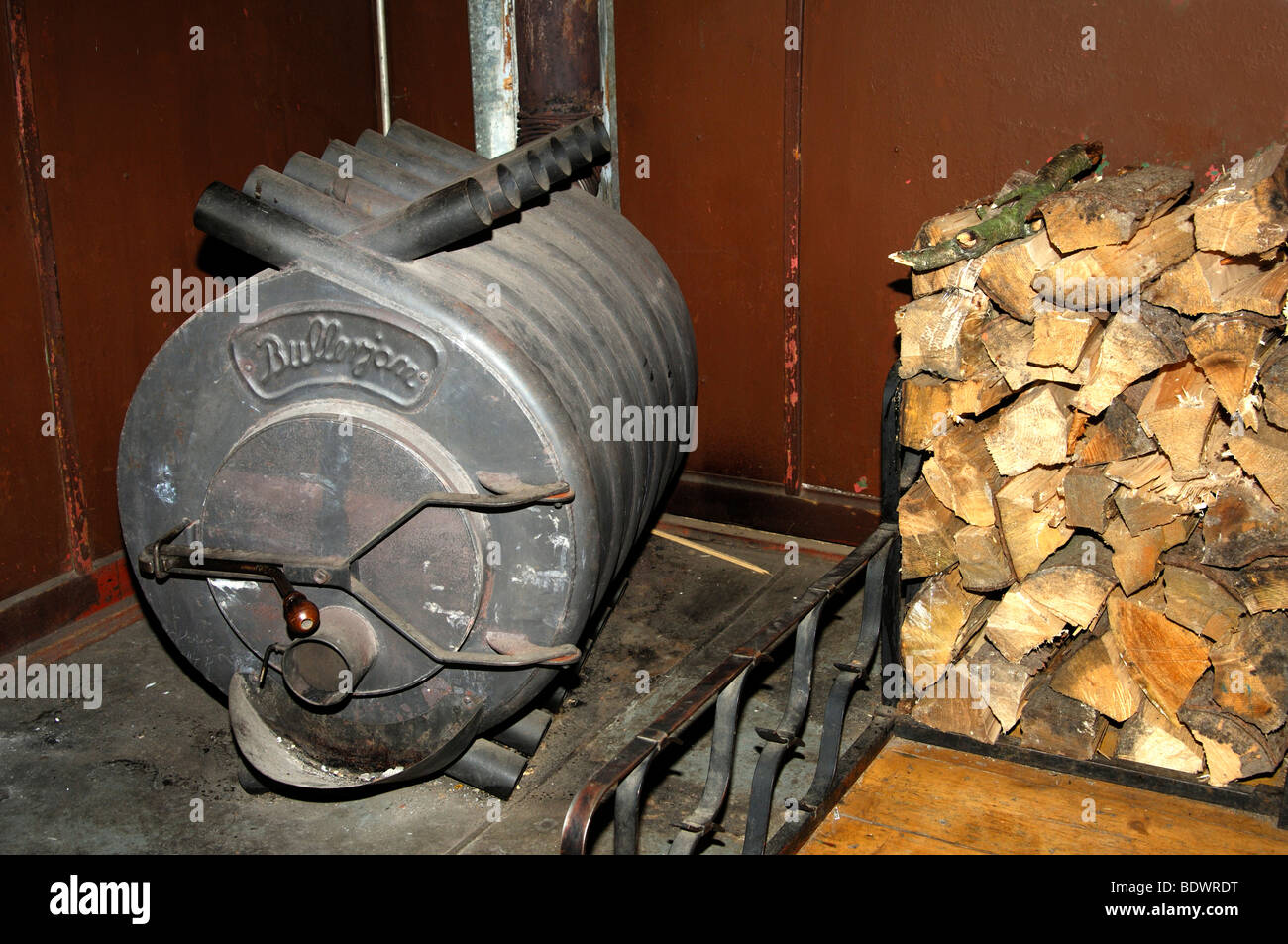 hot air furnace bullerjan and a heap of firewood logs stock photo royalty free image 25768116. Black Bedroom Furniture Sets. Home Design Ideas