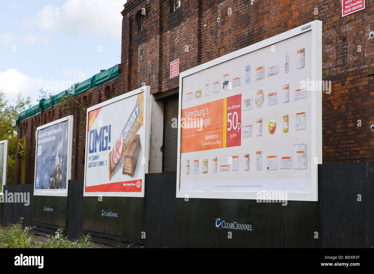 White apron sainsburys - Clearchannel Billboard For Halifax Kitkat And Sainsburys On Side Of Derelict Building In Uk Stock