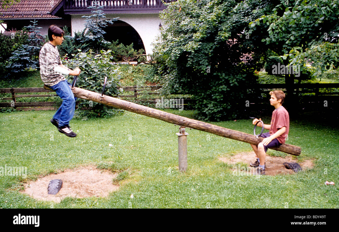 Boy Play Teeter Totter Game Park Balance Physics Beam