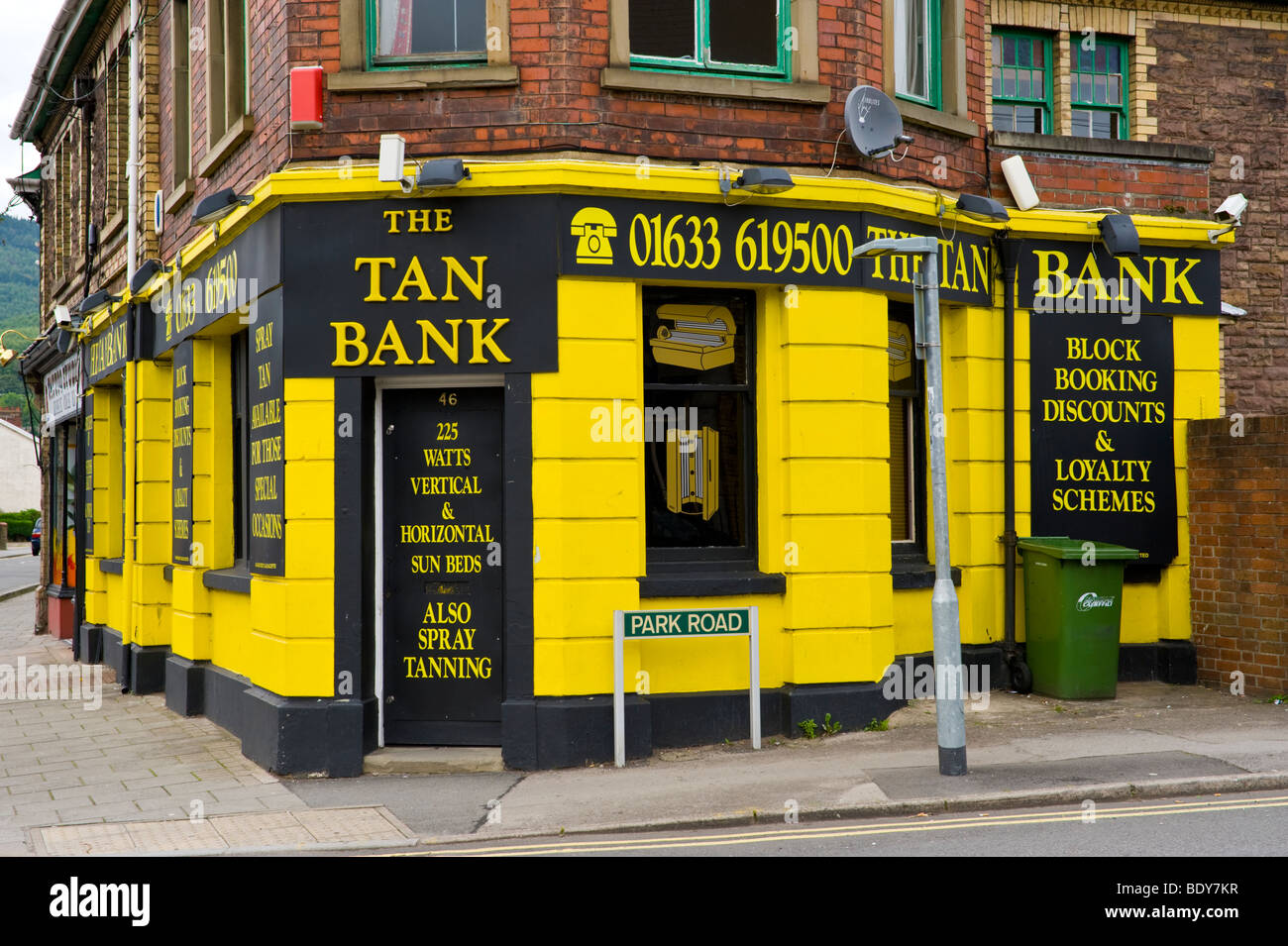 tanning salon stock photos tanning salon stock images alamy exterior of yellow and black the tan bank tanning salon in former bank building uk