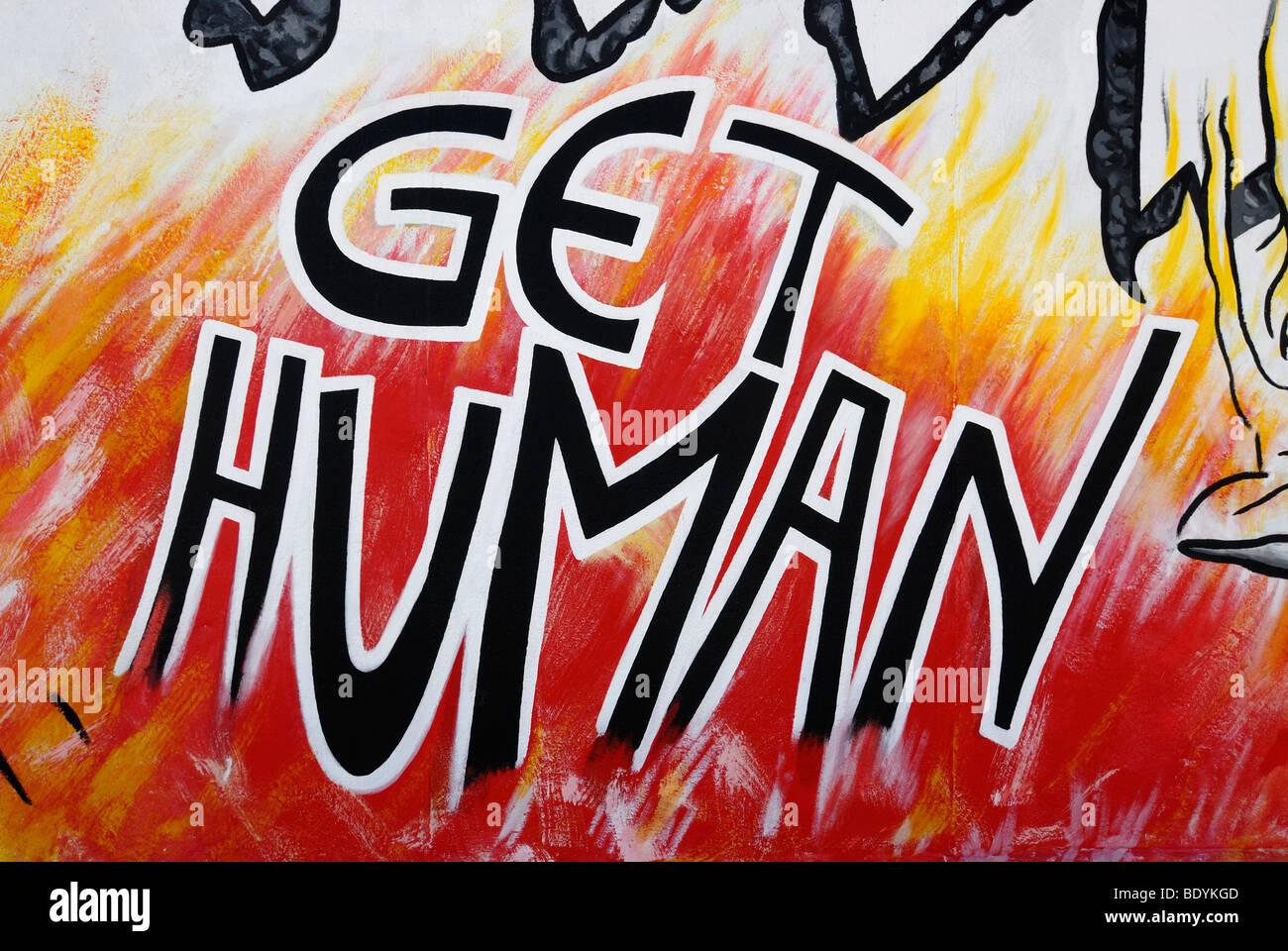 Berlin Wall Art get human, art on the berlin wall, eastside gallery, graffiti
