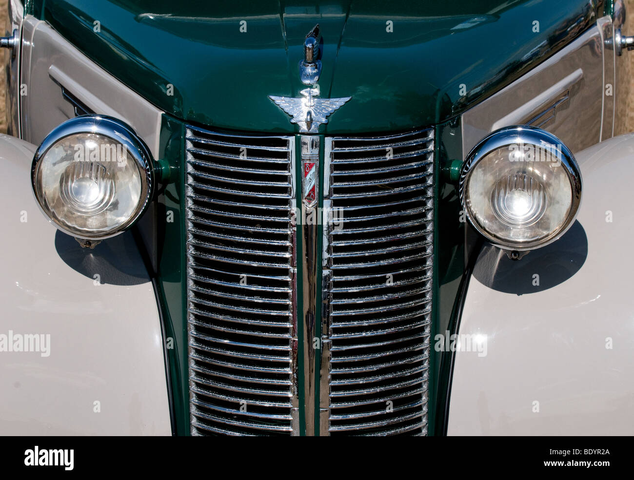 Design of a car radiator - Headlights And Radiator Grill Of A Classic Car On Display At A Country Show In Essex