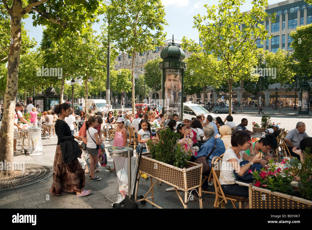 Outdoor cafe in paris with tower in background - People Eating At An Outside Cafe The Champs Elysee Paris France Stock