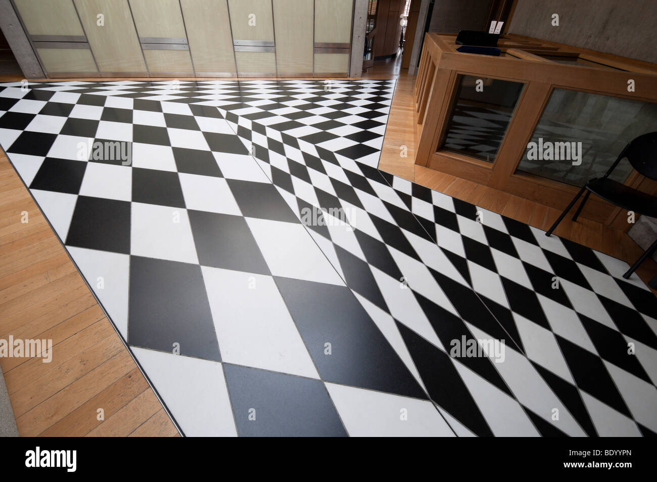 Interiors of the holyrood parliament buildings in edinburgh interiors of the holyrood parliament buildings in edinburgh scotland floor tile pattern in the black and white corridor dailygadgetfo Images