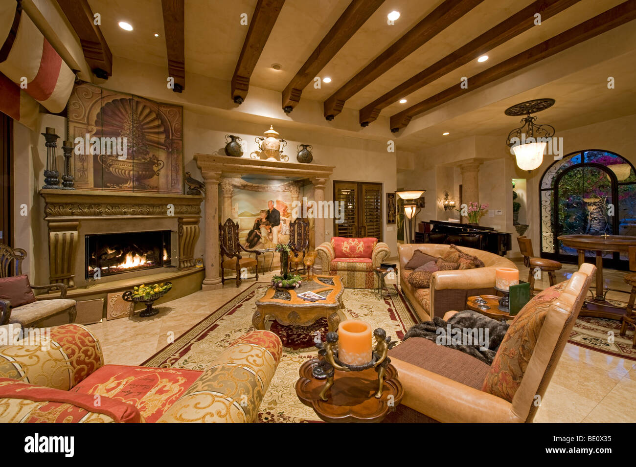 Lavishly decorated living room shows ornate wood carving textiles