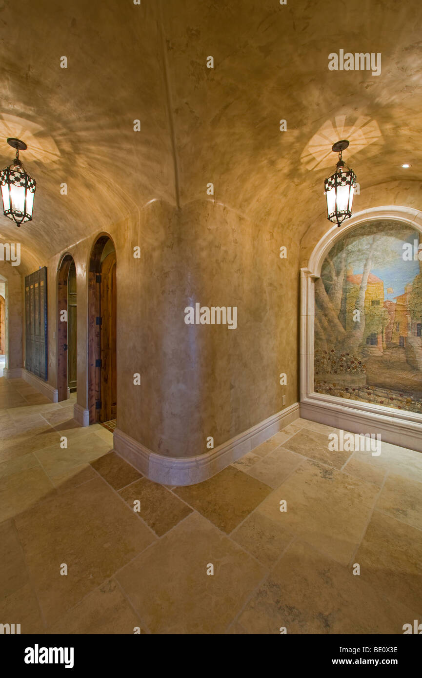 Hallway finished in venetian plaster with arched doorways and art nooks stock image