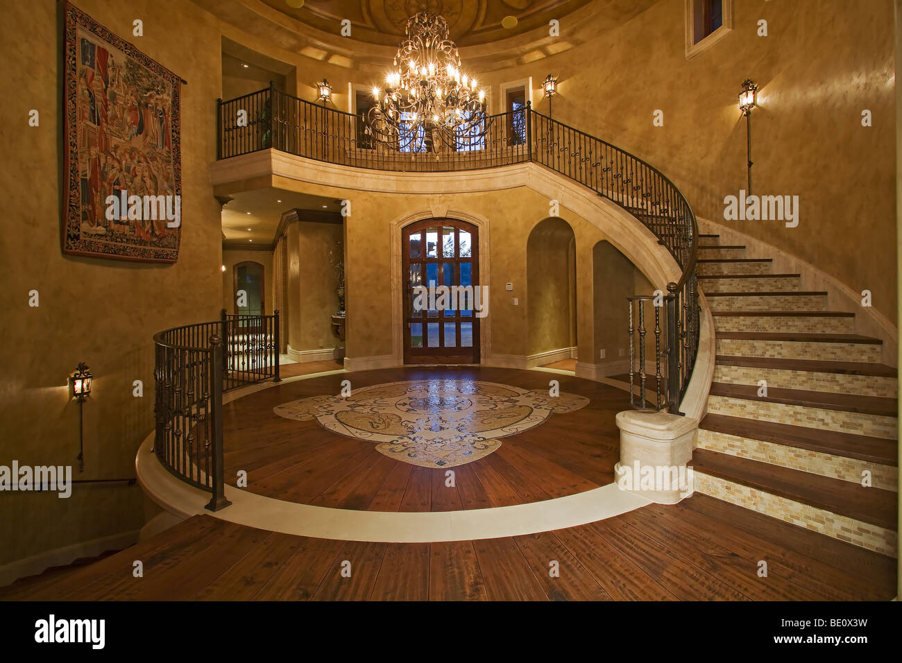 Large Foyer Images : Stunning faux finished ceiling is seen in large foyer with