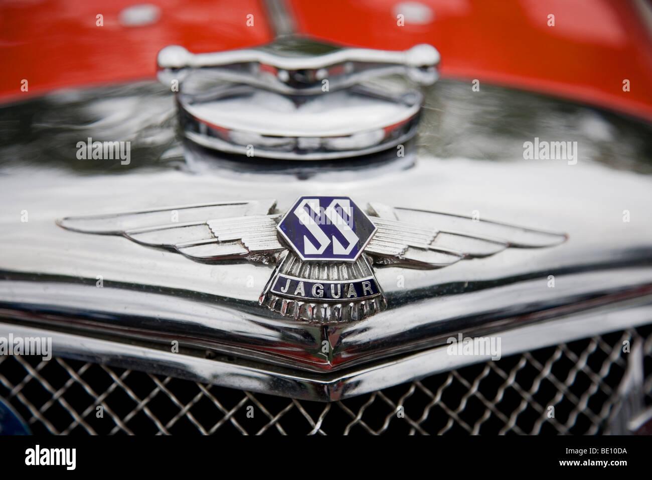 Front End Of A Jaguar Vintage Sports Car And Jaguar Ss Badge At