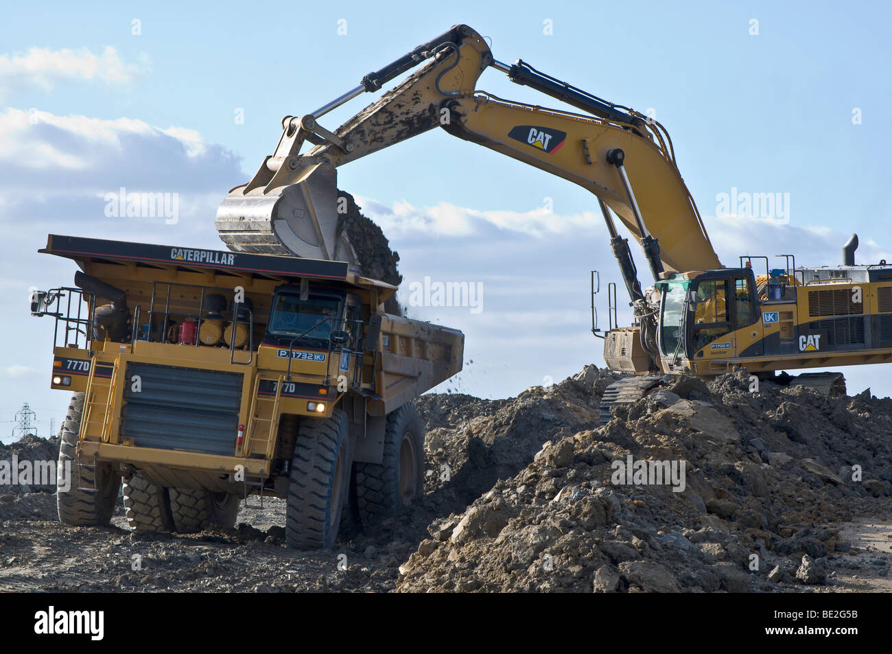Big earth moving equipment at open cast mining site ...