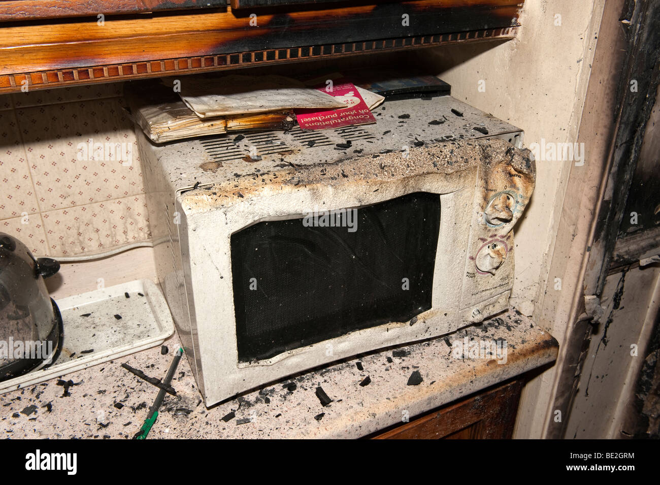 Melted Microwave Oven Following Kitchen Fire In House