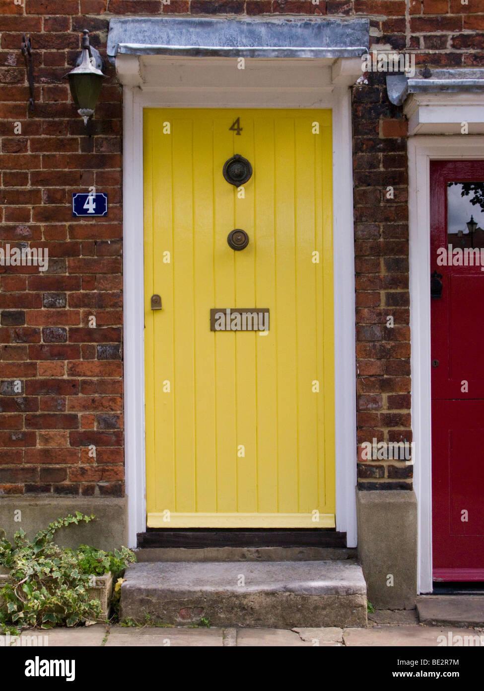 Yellow Front Door In A Row Of Victorian Terraced Houses