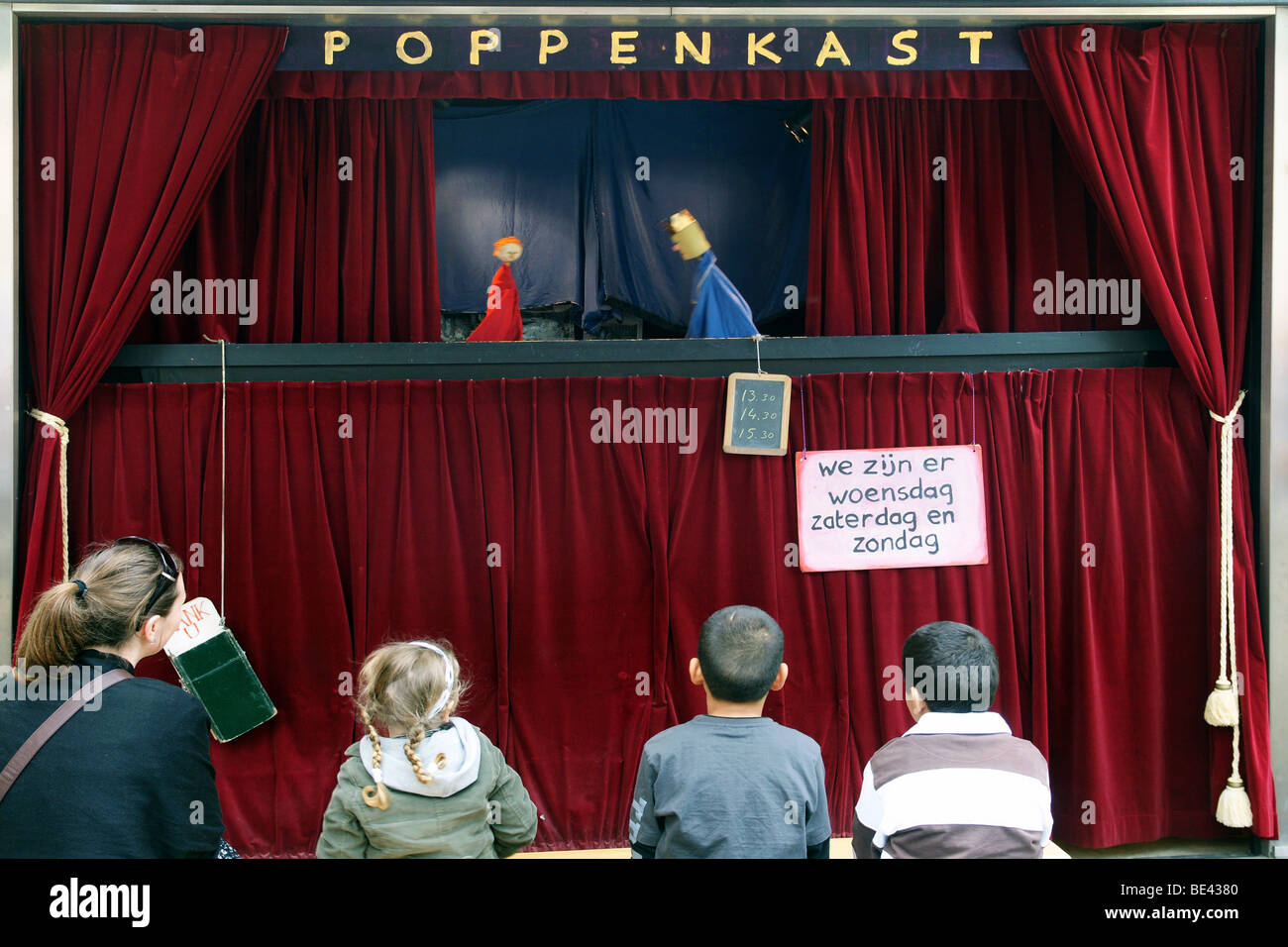 Stock photo dramatic red old fashioned elegant theater stage stock - Puppet Theatre Stage In Rotterdam Streets Outdoors With Children Watching The Play Having Red Curtains