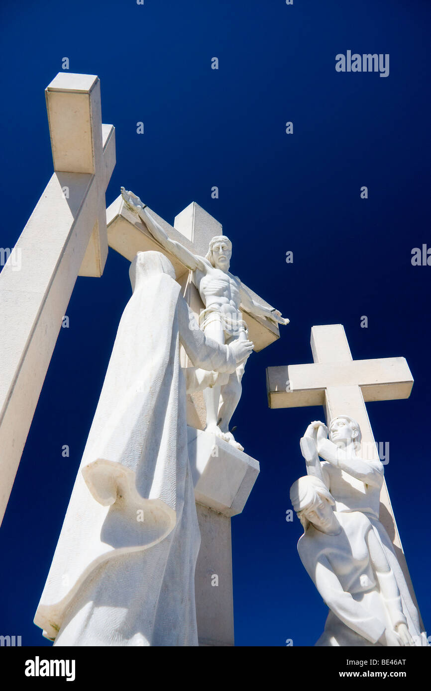 white marble statues of jesus christ on the cross surrounded by