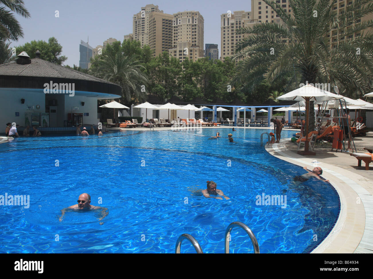 People swimming in the pool at the sheraton hotel on for Pool safety dubai