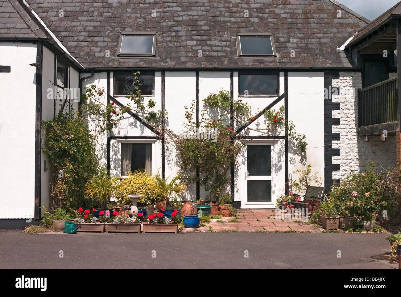 English Barn Conversion And Small Patio Garden