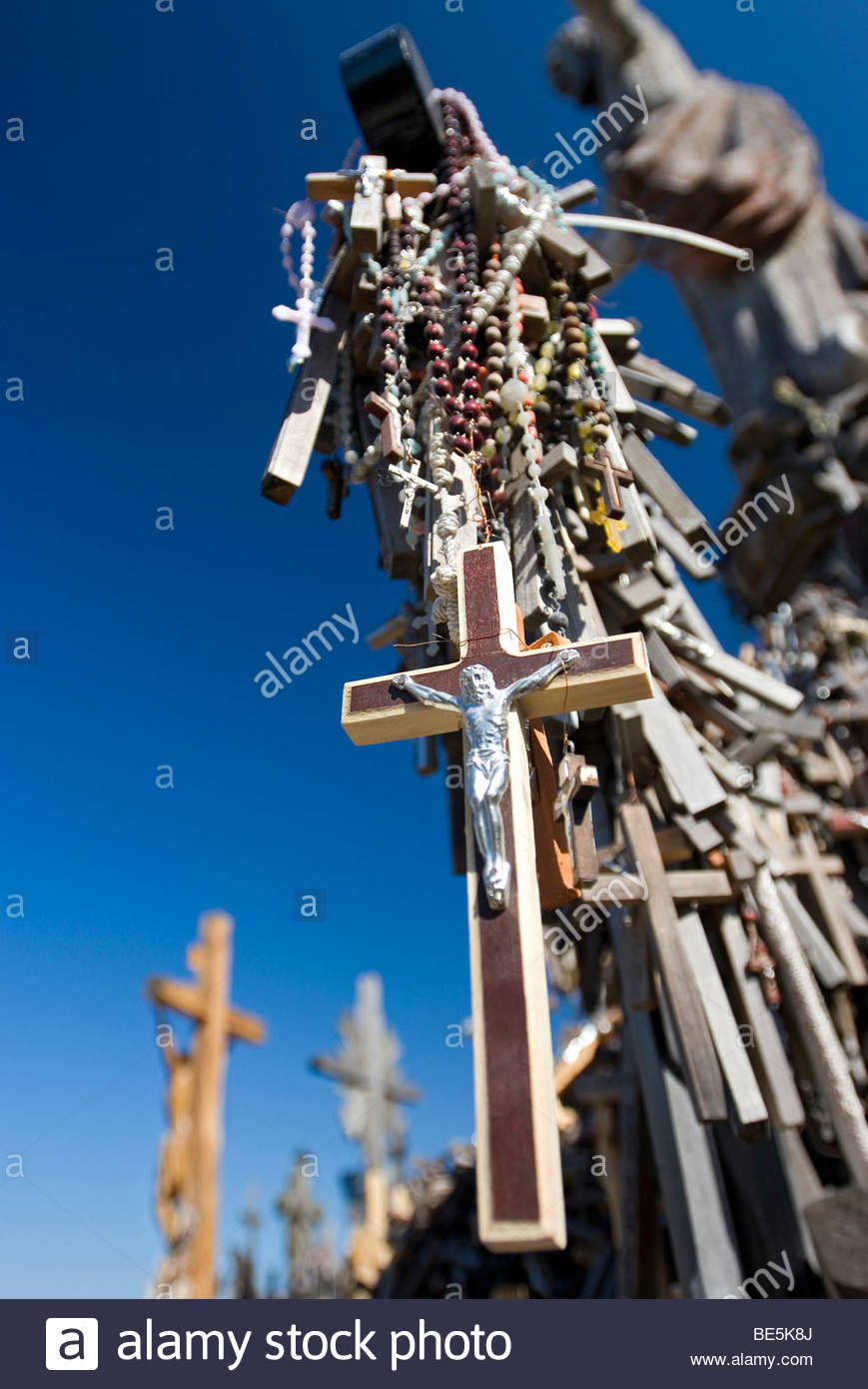 jesus on a small wooden cross hill of crosses siauliai