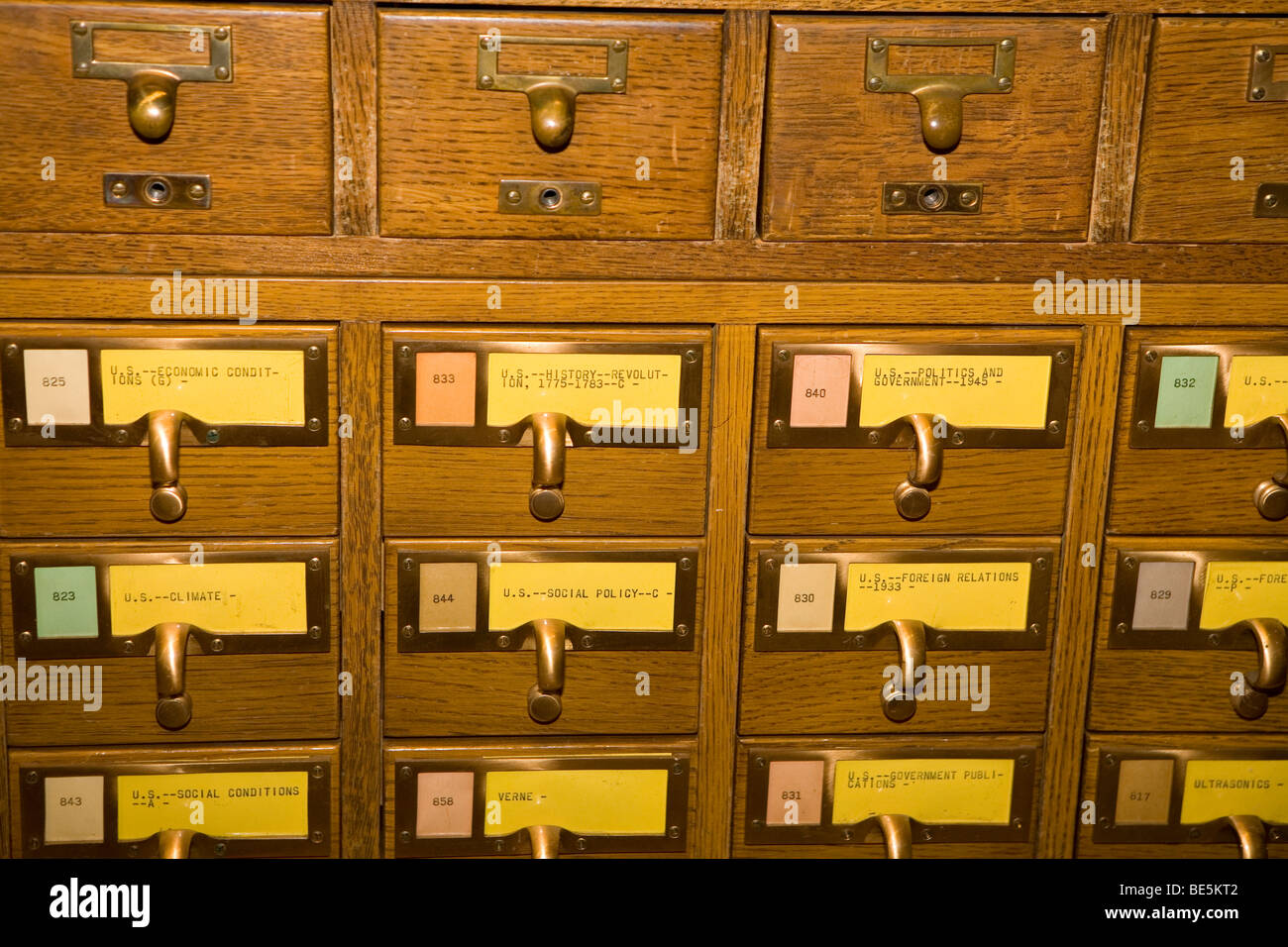 Detail of old-fashioned library card catalog drawers with labels ...