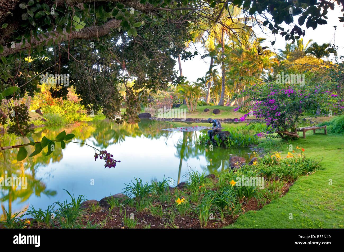 Pond And Garden With Sculpture At Na Aina Kai Botanical Gardens. Kauai,  Hawaii