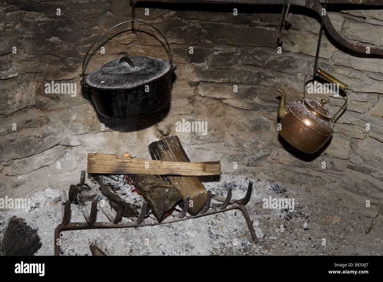 Fireplace with cast iron pot and kettle Stock Photo, Royalty Free ...