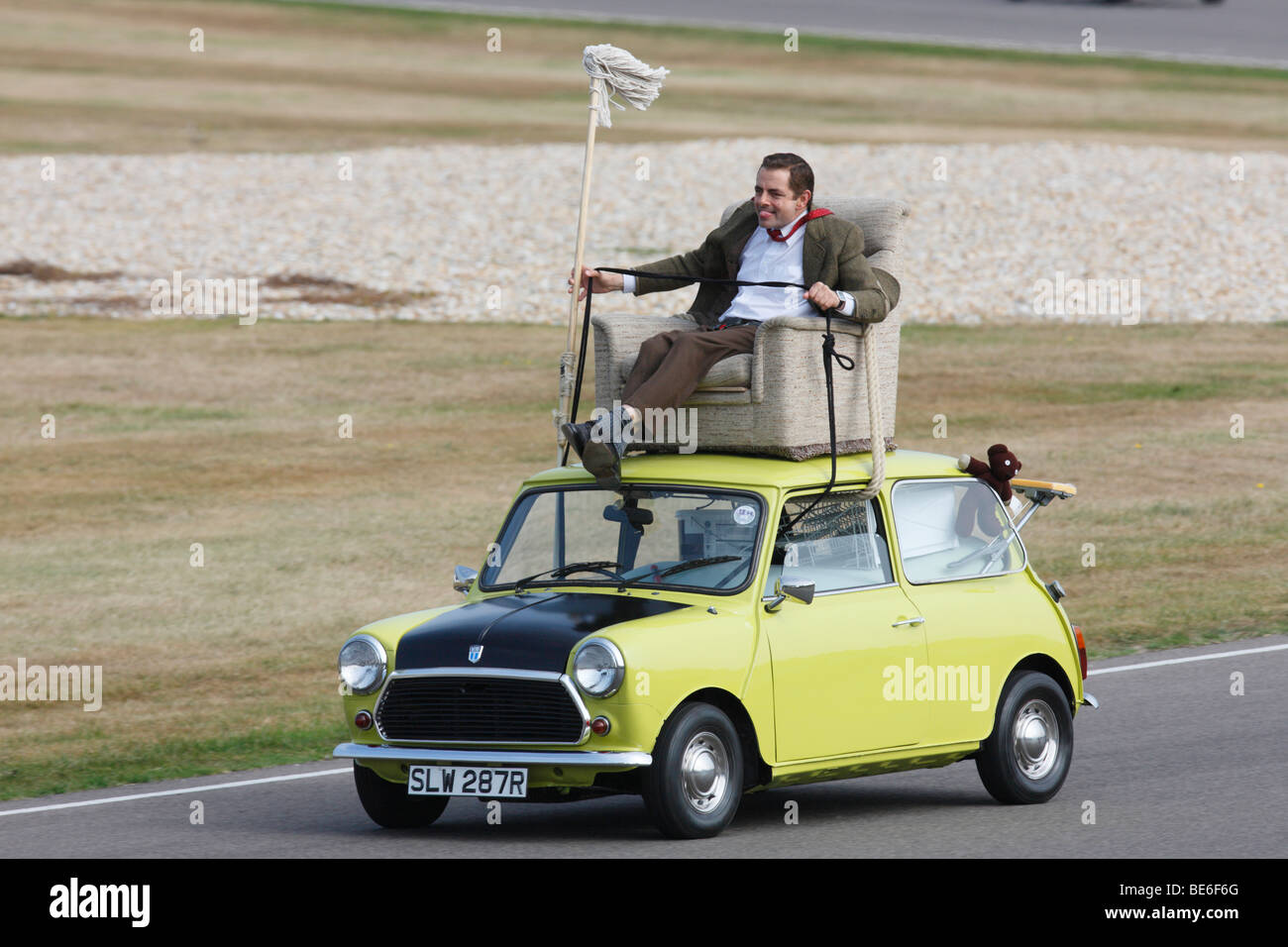Mr Bean Driving A Classic Mini From Arm Chair On Its Roof Stock Photo Royalty Free Image