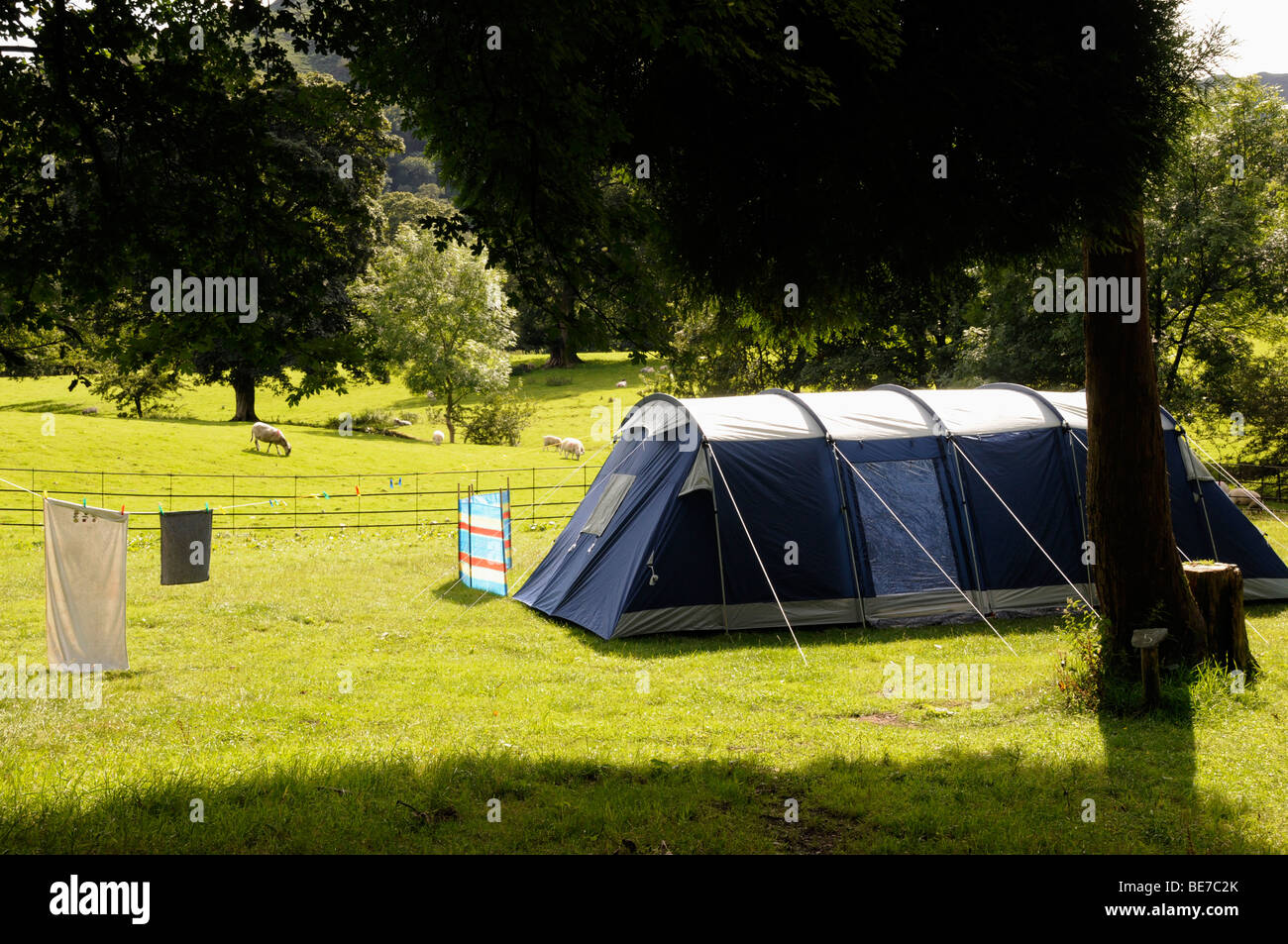 Large family tent in sunshine with a clothes line in the Lake District on a stay-cation Cumbria. United Kingdom & Large family tent in sunshine with a clothes line in the Lake ...