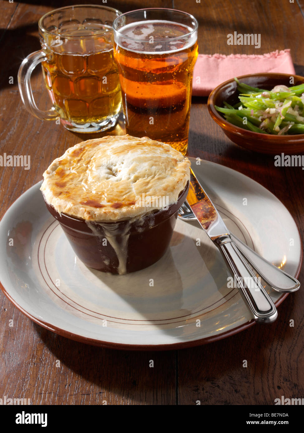 Inidual chicken pie with runner beans and beer in a table setting & Inidual chicken pie with runner beans and beer in a table setting ...