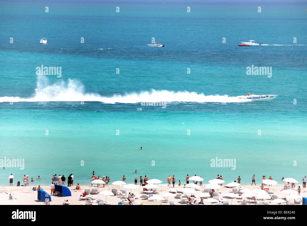 People On The Beach Watching A Motor Boat Racing South Miami Florida USA