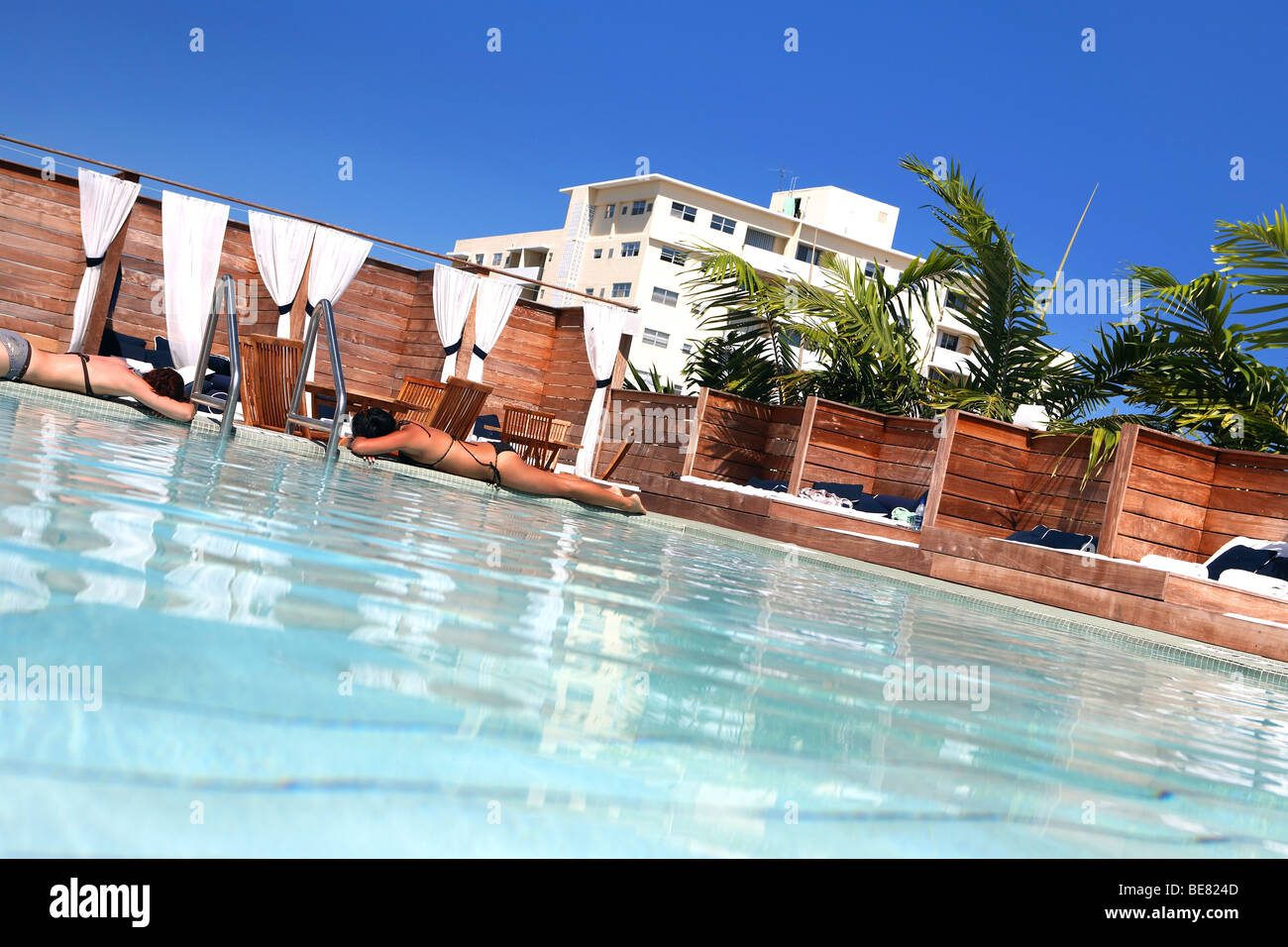two women sunbathing at the rooftop pool of the catalina. Black Bedroom Furniture Sets. Home Design Ideas
