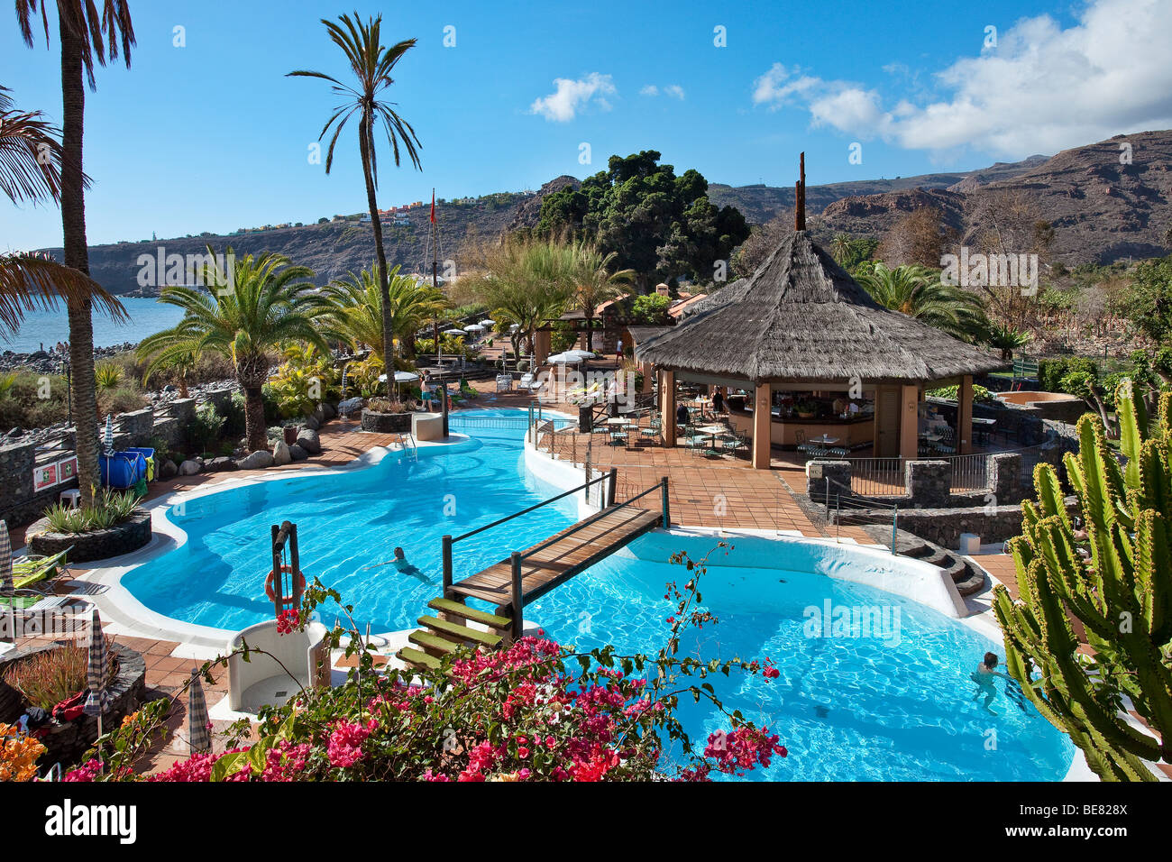View over the swimming pool of jardin tecina hotel in the for Hotel tecina jardin la gomera