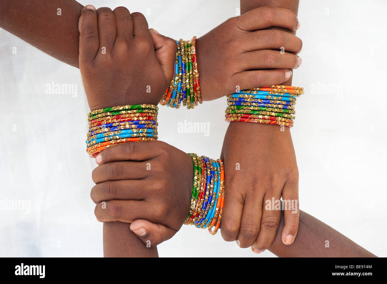 Indian girls hands wearing bangles holding their wrists making a ...