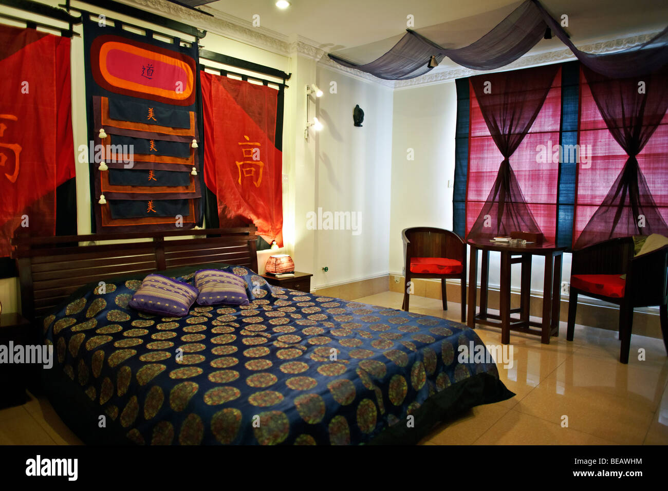 A Boutique Hotel Traditionally Decorated Bedroom Suite In A Boutique Hotel Phnom