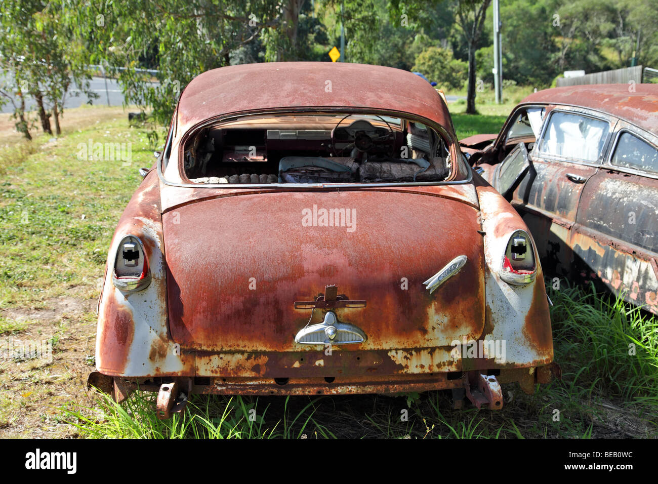 Rusted old cars in a grassy field Hudson Super Swift Stock Photo ...