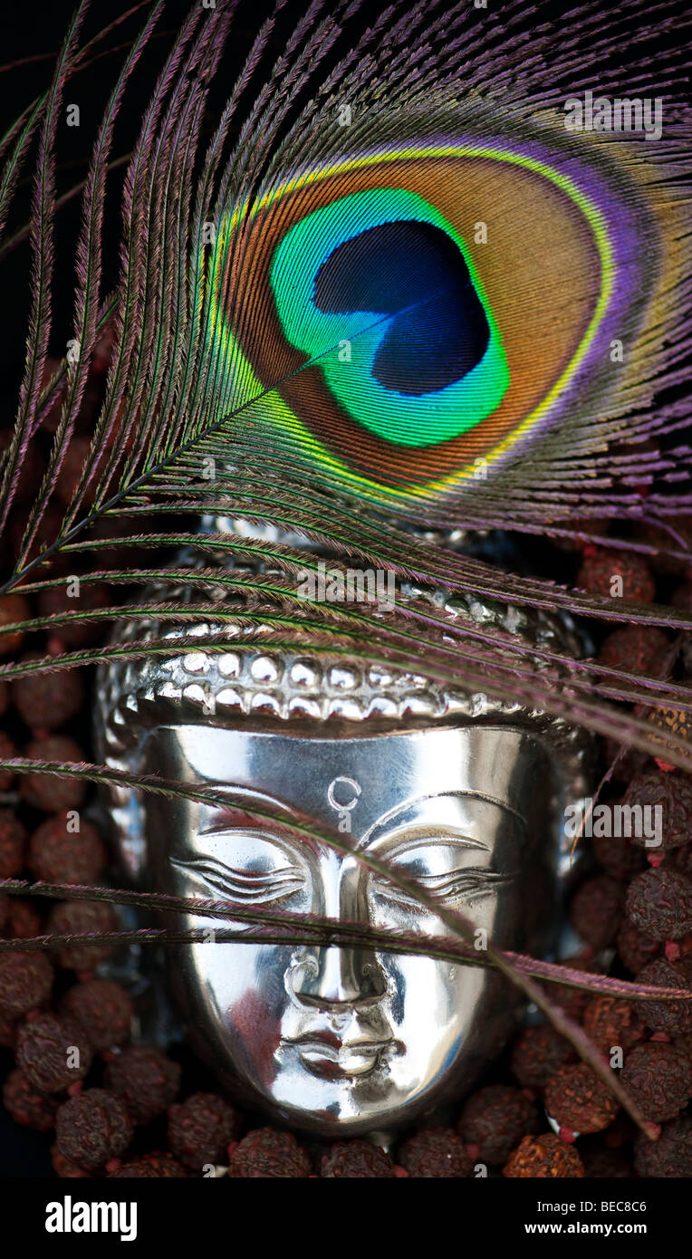 Buddha head peacock feather and prayer beads india stock photo buddha head peacock feather and prayer beads india biocorpaavc Gallery