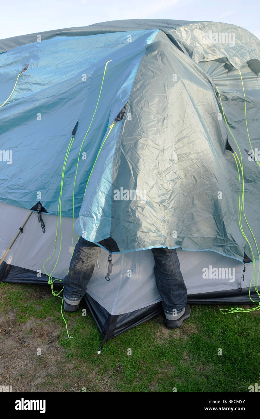A man struggles with the erection of a large tent & A man struggles with the erection of a large tent Stock Photo ...
