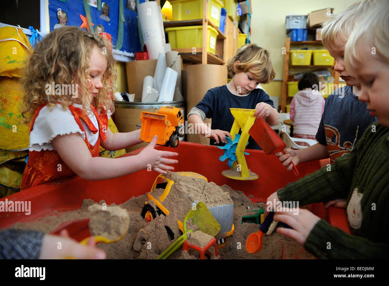 children playing with toys in a sandpit at a sunday school uk - Images Of Children Playing At School