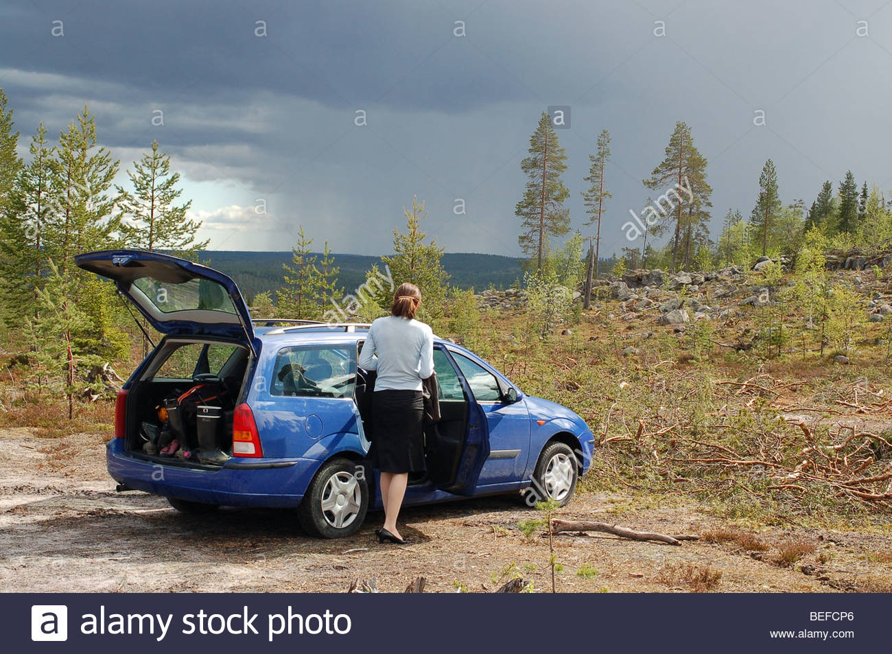 Changing clothes in a car - Stock Photo Woman Changing Clothes From Urban Dress To Outdoors Gear Rovaniemi Finland