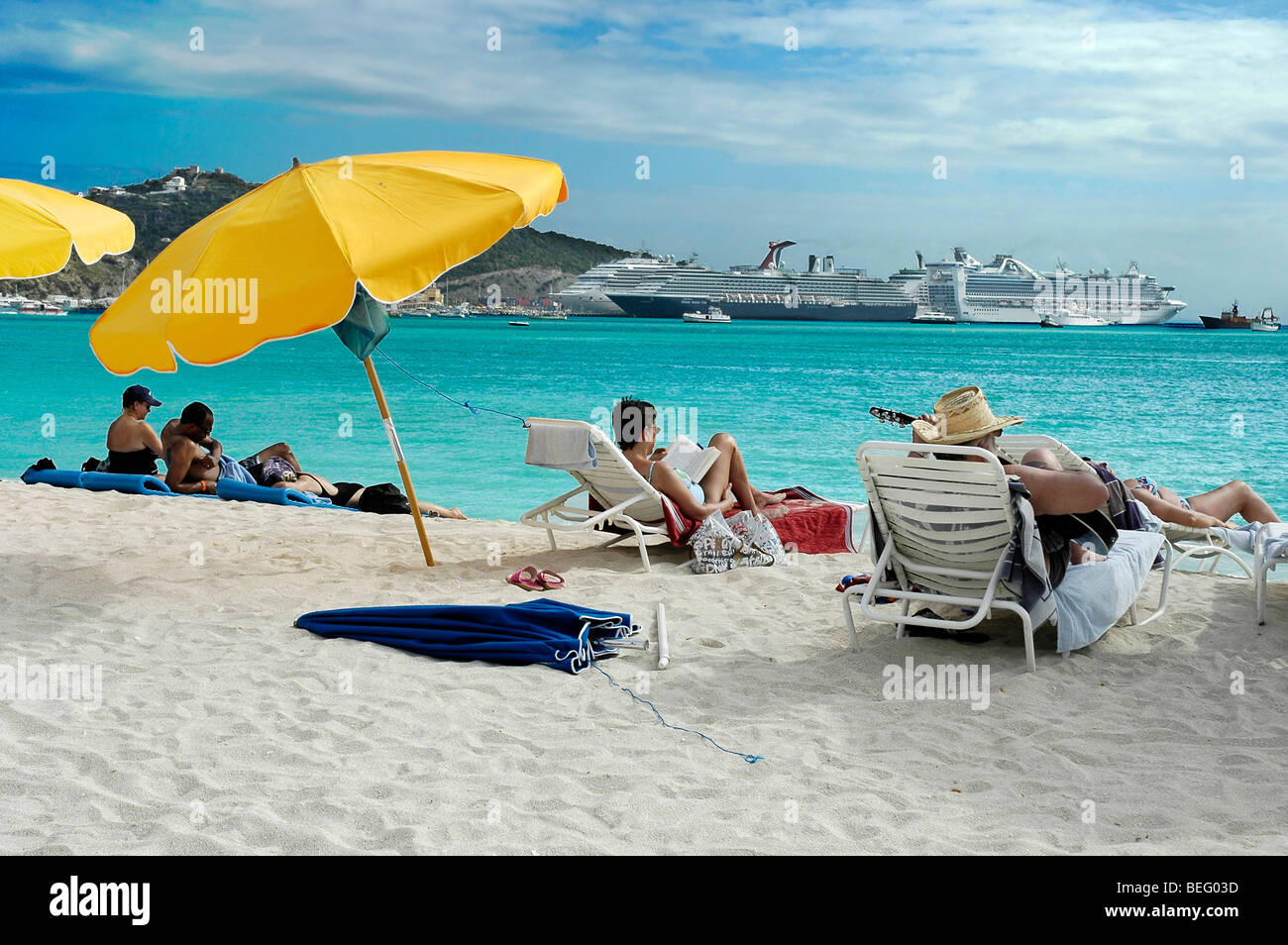 People Relaxing On The Sandy Beach Of Philipsburg St Martin Netherlands Antilles Cruise Ships Docked In Background