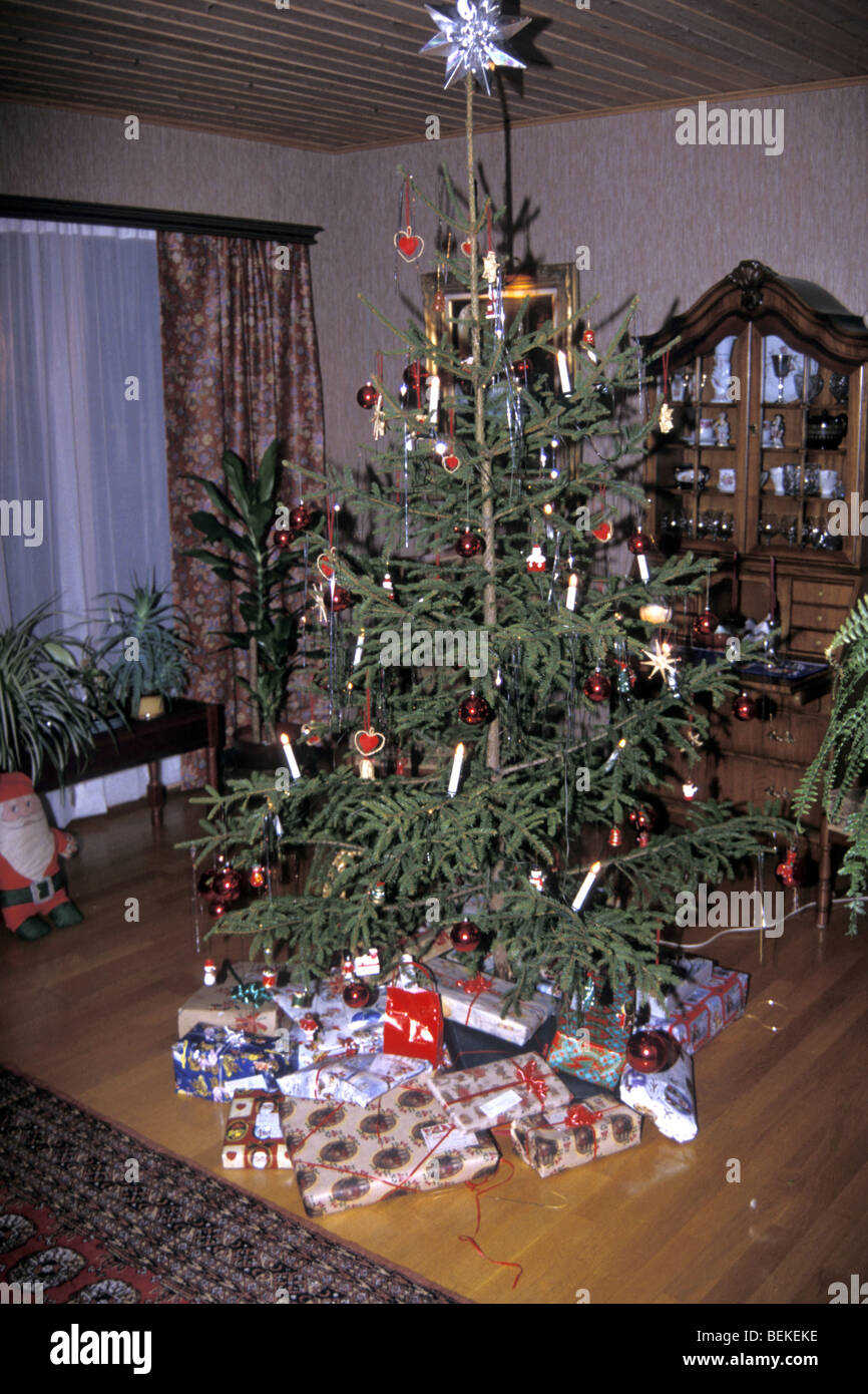 1960s christmas tree surrounded with gifts in common for A common decoration for the top of the tree