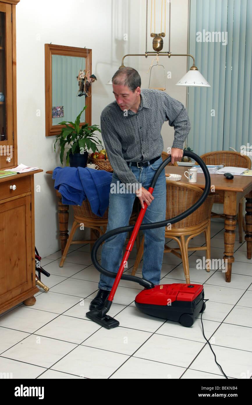 houseman housekeeping cleaning vacuum cleaner stock photo royalty