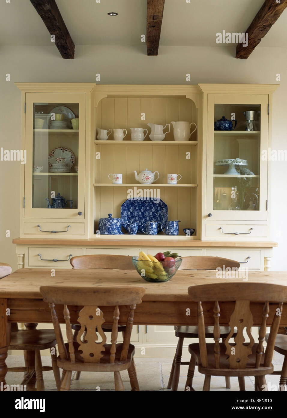 Cream Dresser With Glazed Doors In Country Dining Room Old Pine Table And Chairs
