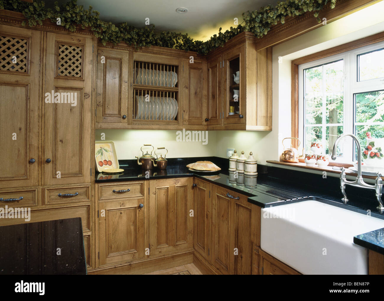 Belfast sink below window in country kitchen with fitted for Oak fitted kitchen