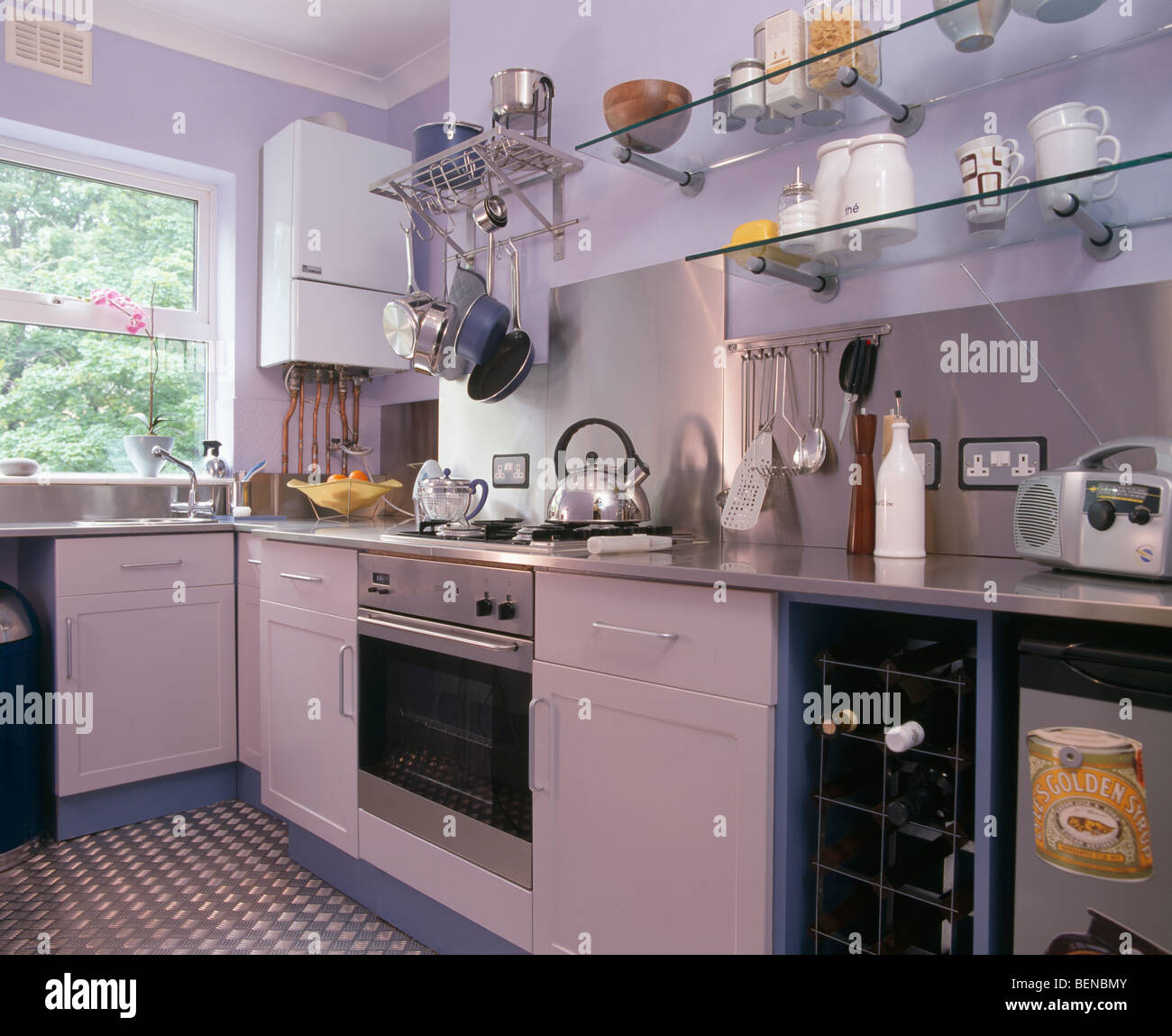 Glass shelving and stainless steel oven in modern mauve for Mauve kitchen walls