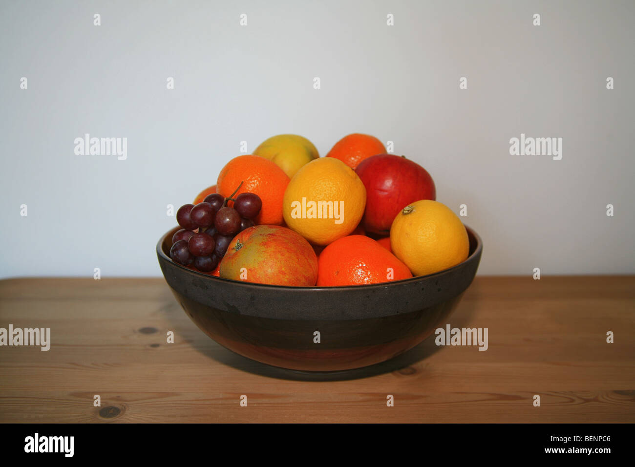 Still Life Study Of A Fruit Bowl On A Wooden Kitchen Table