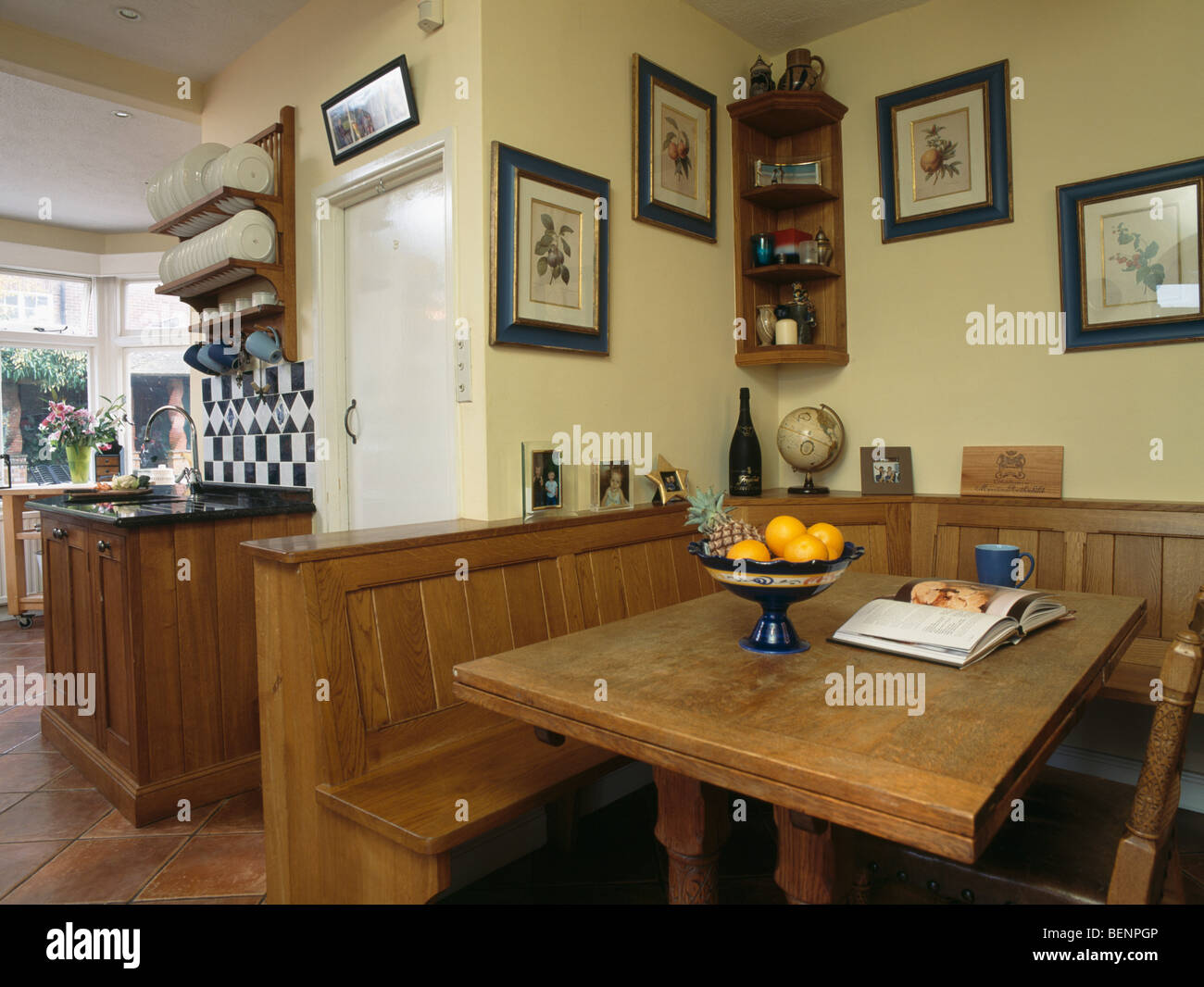 Wooden table and fitted bench seating in dining area of for Wooden fitted kitchen