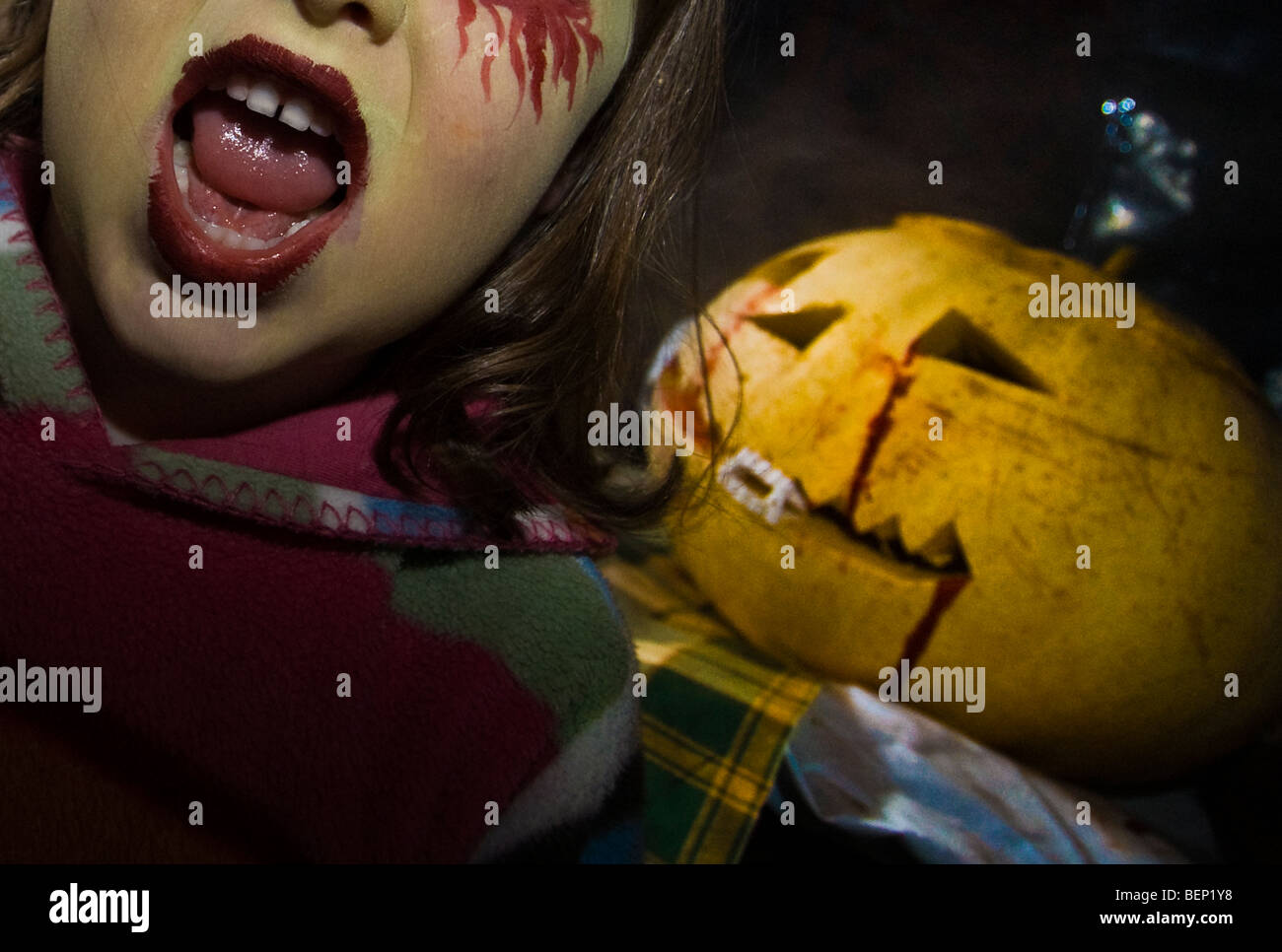 Scary Pumpkin Painting A Young Girl With Scary Face Paint And A Pumpkin Lantern At