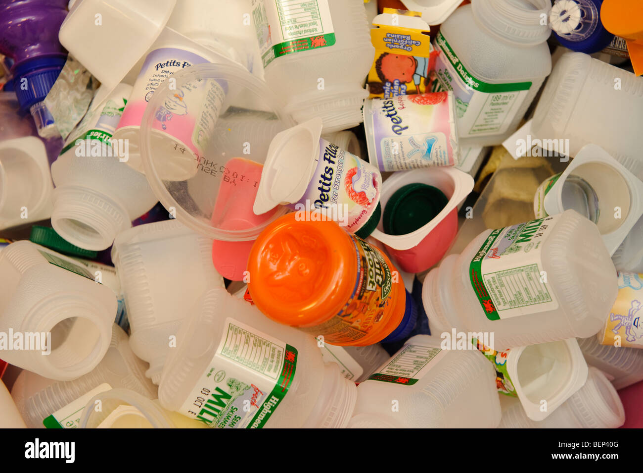pile of waste plastic bottles and yogurt pots food packaging awaiting stock photo royalty free. Black Bedroom Furniture Sets. Home Design Ideas