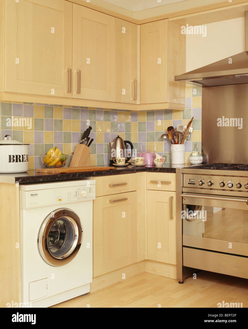 Kitchen Washing Machine ~ Washing machine and stainless steel range oven in modern