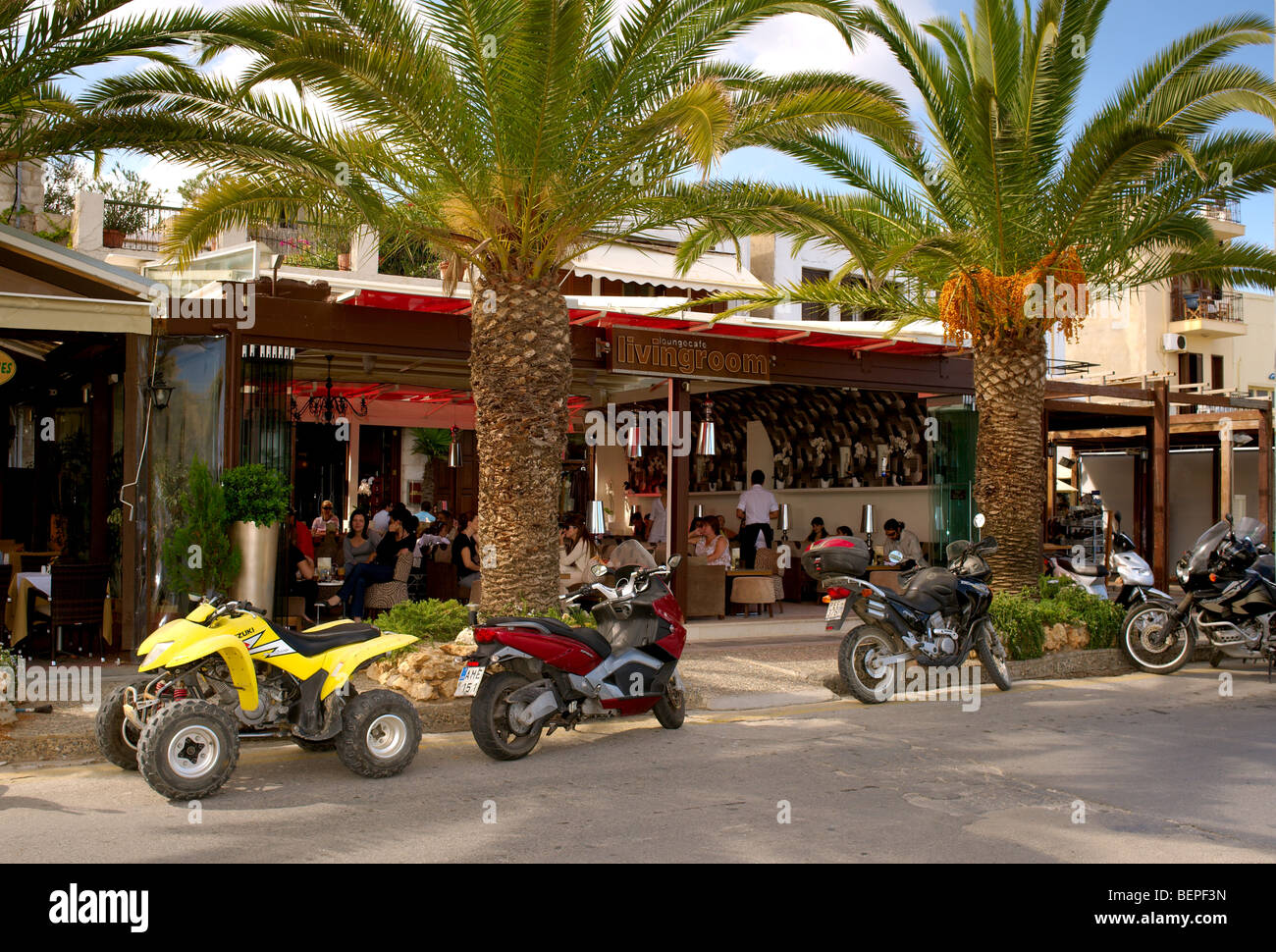 Crowded Living Room Caf Bar With Motorbikes And Palm Trees Rethymnon Crete Greece