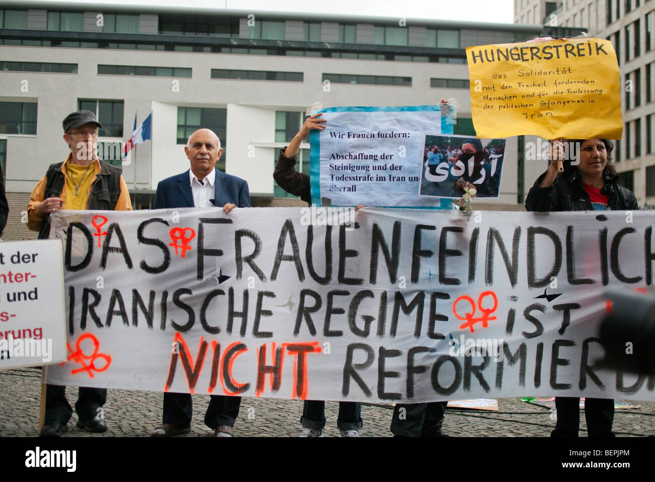 Iranian oppositors protesting against the islamic government and iranian oppositors protesting against the islamic government and demanding democracy in iran branderburg gate berlin germany sciox Choice Image