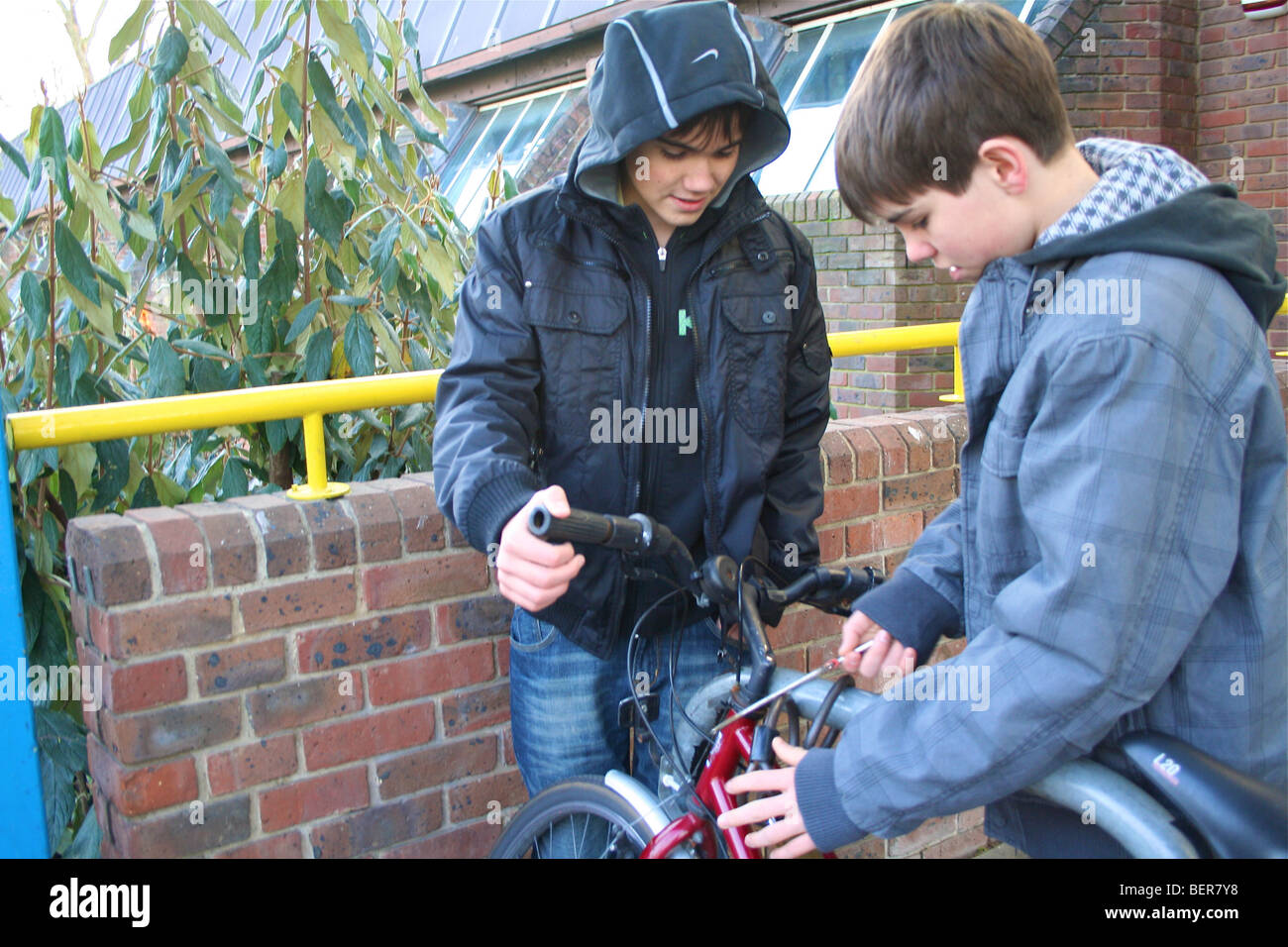 kids stealing a bicycle Stock Photo, Royalty Free Image ...